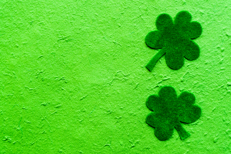 Happy St Patricks Day message on green paper clover and bright green Mulberry paper background Stock Photo