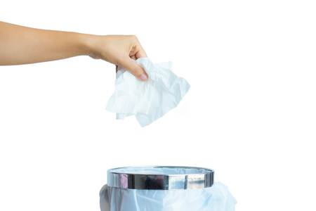 Women hand throwing white tissue paper in to a trash bin isolate on white background.