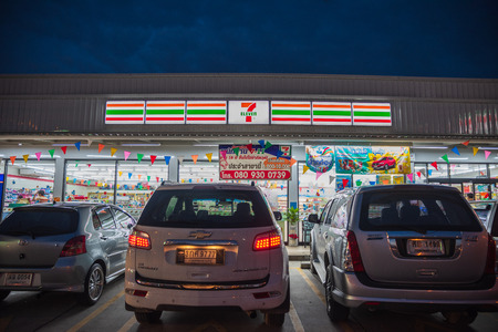 Banglamung, Chonburi /Thailand - April 22, 2018: 7 Eleven shop blue sky background during sunset. 7-Eleven is a Japanese-owned American international chain of convenience stores.