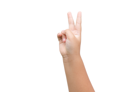Boy hand showing two fingers as victory sign on white background