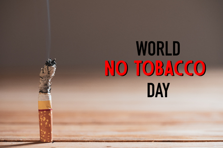 World No Tobacco Day, May 31. STOP Smoking. Close up burn cigarettes.
