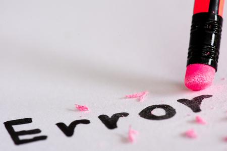 Erase the word Error with a rubber concept of eliminating the error, mistake. closeup of a pencil erasing an