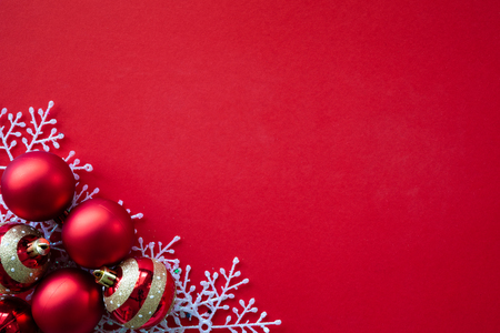 Christmas background concept. Christmas gift box, white snow, red ball, golden star on red background.