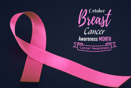 Pink ribbon on black background  for supporting breast cancer awareness month campaign.