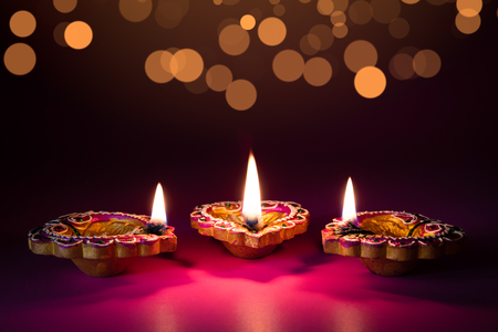 Happy Diwali - Clay Diya lamps lit during Dipavali, Hindu festival of lights celebration Stock Photo