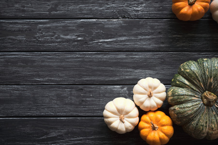 Top view of Pumpkin on old wooden backgound. Thanksgiving day concept. Stock Photo