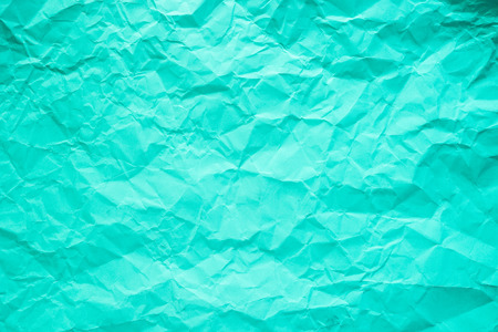Cyan and bright green crumpled paper texture background. Stock Photo