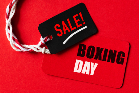 Boxing day Sale text on a red and black tag. Shopping concept. Stock Photo