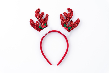 Christmas background concept. Top view of Headband reindeer on white background. Stock Photo