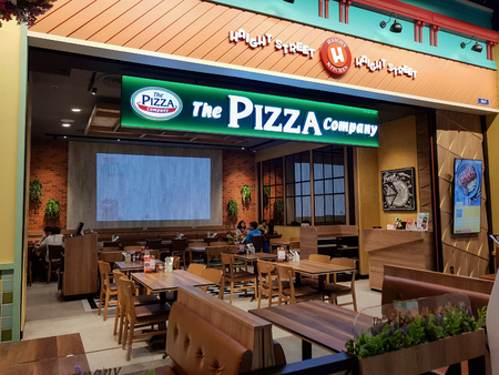 Chon Buri, Thailand - December 21, 2018: Exterior view of The Pizza company Restaurant with Customers, Terminal 21 Pattaya branch. Editorial