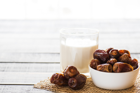 Milk and dates fruit. Muslim simple Iftar concept. Ramadan food and drinks.