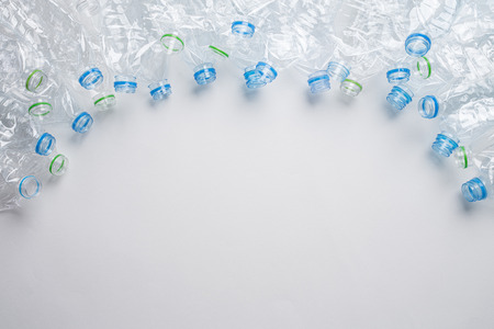 Frame of used plastic bottles background. Recycle concept Imagens