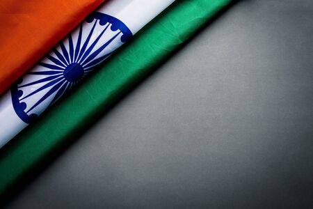 Top view of National Flag of India on gray background. Indian Independence Day.
