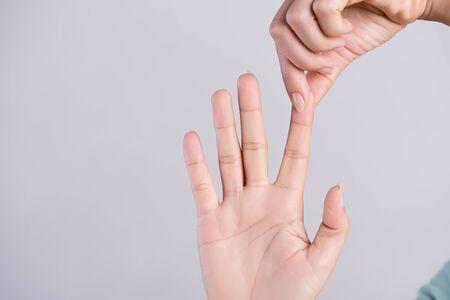 Healthcare and medical concept. Woman massaging her painful Index finger. Standard-Bild