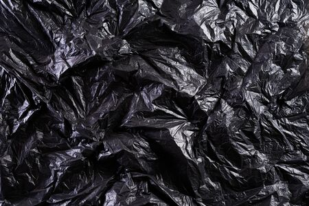 Top view of Black plastic bag texture and background. Reduction of plastic bags for natural treatment. Recycle and World Environment Day concept. 版權商用圖片
