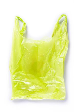 Top view of Green plastic bag on white background. Reduction of plastic bags for natural treatment. Recycle and World Environment Day concept. Stock Photo