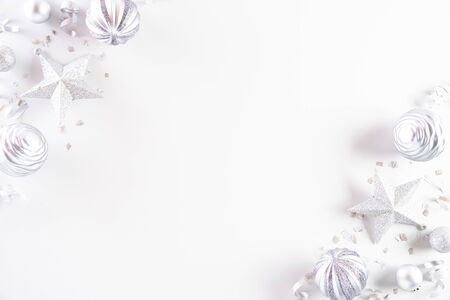 Christmas background concept. Top view of Christmas decoration, ball, star with snowflakes on white background.
