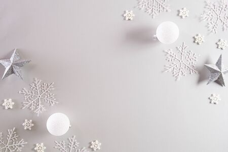 Christmas background concept. Top view of Christmas ball with snowflakes on light gray pastel background.