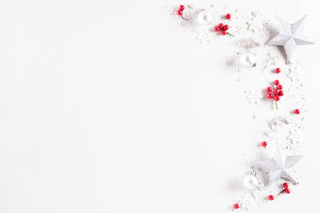 Christmas background concept. Top view of Christmas decoration, ball, star with snowflakes and red berries on white background.