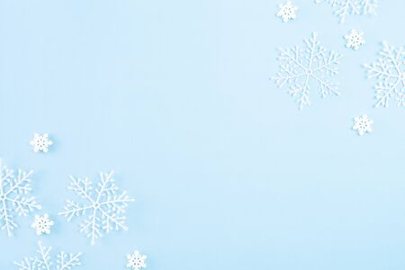 Christmas background concept. Top view of Christmas ball with snowflakes on light blue pastel background.