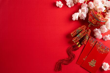 Chinese new year festival decorations pow or red packet, Stringed cracker and gold ingots on a red background. Chinese characters FU in the article refer to fortune good luck, wealth, money flow.