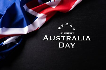 Australia day concept. Australian flag with the text Happy Australia day against a blackboard background. 26 January. 스톡 콘텐츠