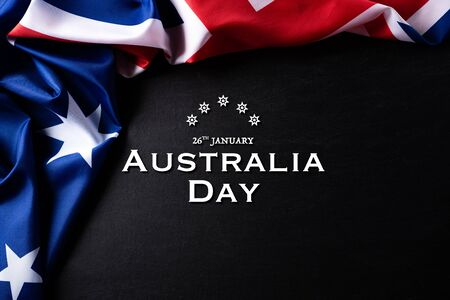 Australia day concept. Australian flag with the text Happy Australia day against a blackboard background. 26 January. 写真素材