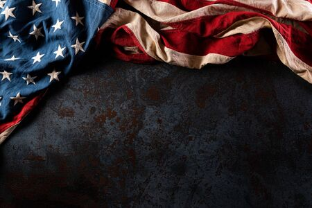 Happy Memorial Day. American flags with the text REMEMBER & HONOR against a black stone texture background.