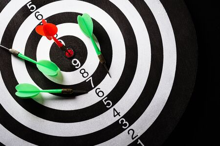 Top view of the target dartboard with arrows on dark background, business marketing, success, growth up and winner concept.