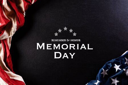 Happy Memorial Day. American flags against a black background. May 25.