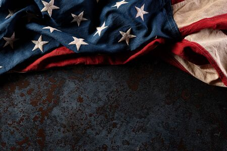 Happy Memorial Day. American flags  against a black stone texture background. May 25. Фото со стока