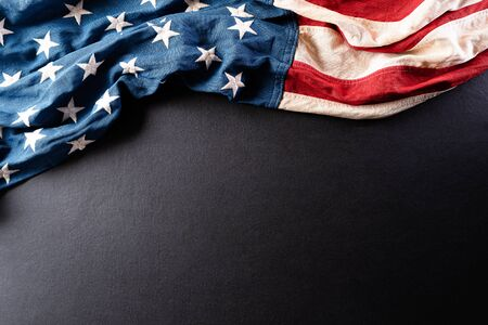 Happy Independence Day. American flags against a black background. July 4.