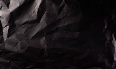Texture of crumpled black paper. Creative vintage for design background.