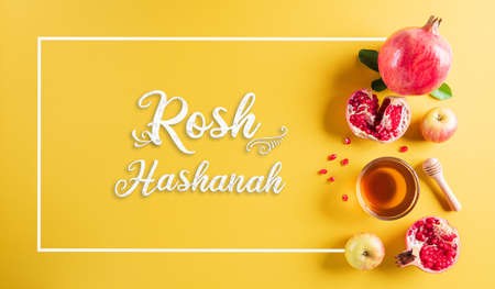 Rosh hashanah (Jewish New Year holiday), Concept of traditional or religion symbols on pastel yellow paper background.