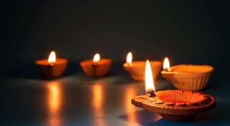 Happy Diwali - Clay Diya lamps lit during Dipavali, Hindu festival of lights celebration Stockfoto