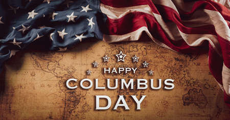 Happy Columbus Day concept. Vintage American flag over retro treasure manuscript. Flat lay, top view with Columbus day text..