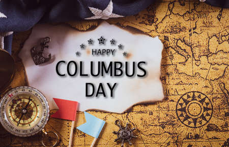 Happy Columbus Day concept. Vintage American flag with compass and retro treasure manuscript.  Flat lay, top view with Columbus day text Archivio Fotografico