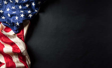 Happy Veterans Day concept. American flags against a blackboard background. November 11.