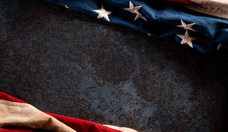 Happy Veterans Day concept. American flags against a dark stone  background. November 11. 版權商用圖片 - 157606589