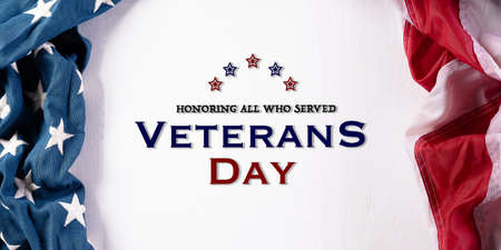 Happy Veterans Day concept. American flags against white wooden background. November 11. Day