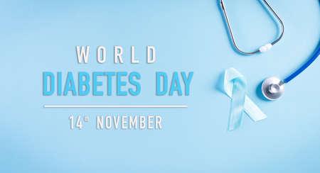 World diabetes day awareness concept, stethoscope with blue ribbon on pastel background,  14 November.