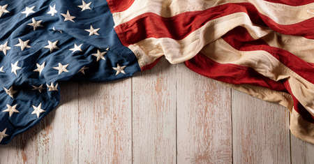 Happy Veterans Day concept. American flags against vintasge wooden background. November 11.