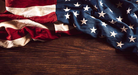 Happy Veterans Day concept. Vintage American flags against old wooden background. November 11.