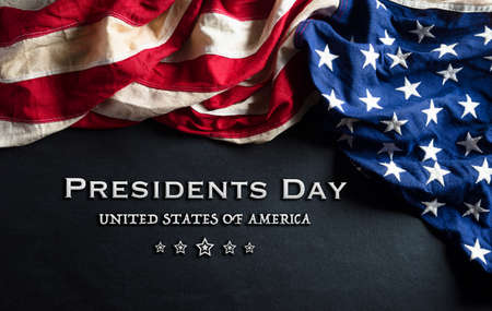 Happy presidents day concept with flag of the United States on black wooden background. Zdjęcie Seryjne