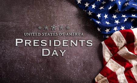 Happy presidents day concept with flag of the United States on dark stone background. Zdjęcie Seryjne
