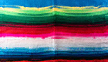 Cinco de mayo background decorated image made from mexican blanket stripes or poncho serape background.