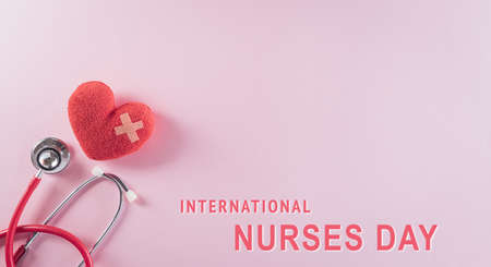 Top view of doctor stethoscope and red heart on pastel background. International nurse day and medical concept.