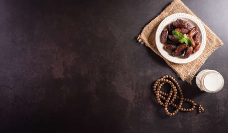 Table top view image of decoration Ramadan Kareem, dates fruit, 