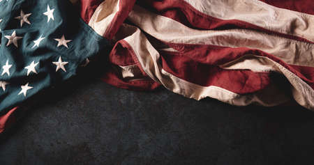 Happy Memorial Day concept. Vintage American flags against dark stone background.