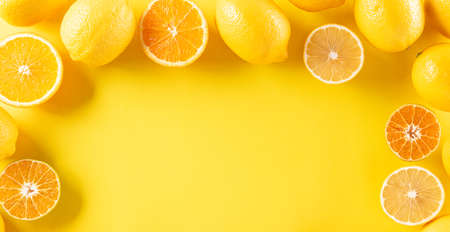 Summer composition made from oranges, lemon or lime on pastel yellow background. Fruit minimal concept. Flat lay, top view, copy space. Zdjęcie Seryjne